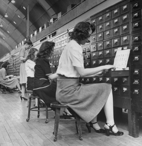Women working in file room of FBI. (Pho