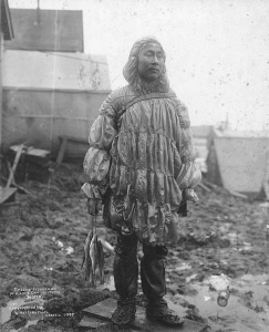 inuit_man_wearing_a_sea_lion_gut_parka-_nome_alaska-_1900-_