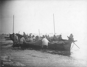 king_island_eskimos_in_the_surf_landing_their_umiak_on_the_beach_nome_alaska_1900_hester_90
